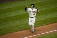 Milwaukee Brewers' Keston Hiura celebrates after hitting a three-run home run during the fourth inning of a baseball game against the St. Louis Cardinals Tuesday, Sept. 15, 2020, in Milwaukee. (AP Photo/Morry Gash)