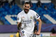Karim Benzema's brace sent Real Madrid into the last 16 of the Champions League