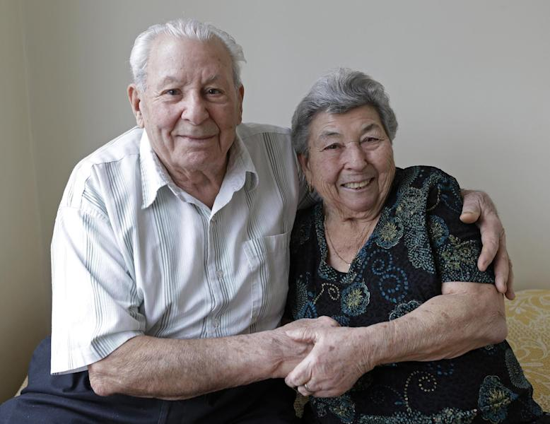 Fortunato and Madalena Corso, a Bensonhurst couple married 72 years who met in Calabria, Italy, and married Feb. 4, 1941, pose for a photograph at their home in New York, Wednesday, Feb. 13, 2013. On Thursday they'll be honored by Brooklyn borough President Marty Markowitz in a celebration of couples married 50 years or more. The Corso's, who met as teenagers in Calabria, Italy, and married Feb. 4, 1941, have seven children, three girls and four boys. (AP Photo/Kathy Willens)