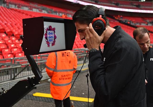 German referee Deniz Aytekin checks out the VAR system ahead of the friendly between England and Italy at Wembley in March (AFP Photo/Glyn KIRK )