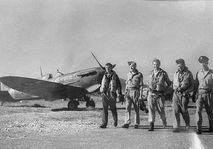 Rake, centre, in a group of pilots leaving their Spitfires after a mission over Italy: a characteristic image of young airmen of the period