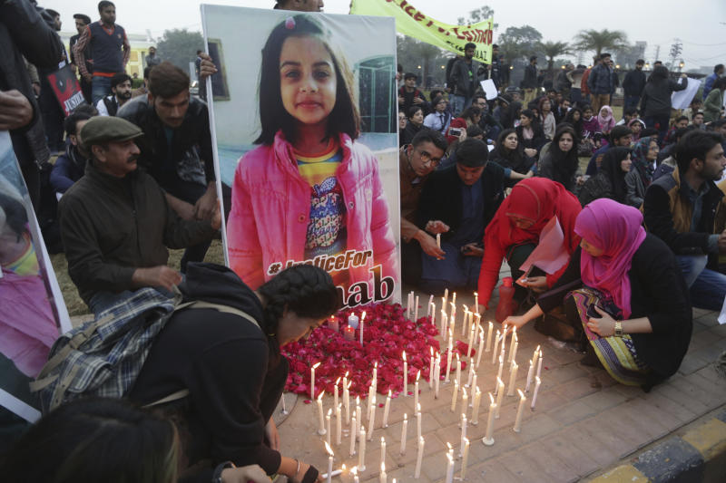 Pakistani students light candles during a protest rally to condemn the rape and killing of Zainab Ansari, an 8-year-old girl, last week in Kasur, Thursday, Jan. 11, 2018, in Lahore, Pakistan. Anees Ansari, Zainab's father, accused the police of being slow to respond when his daughter went missing. Two people were killed and three others were wounded in clashes between angry Kasur residents and police after protesters enraged over her death attacked a police station in the city. (AP Photo/K.M. Chaudary)