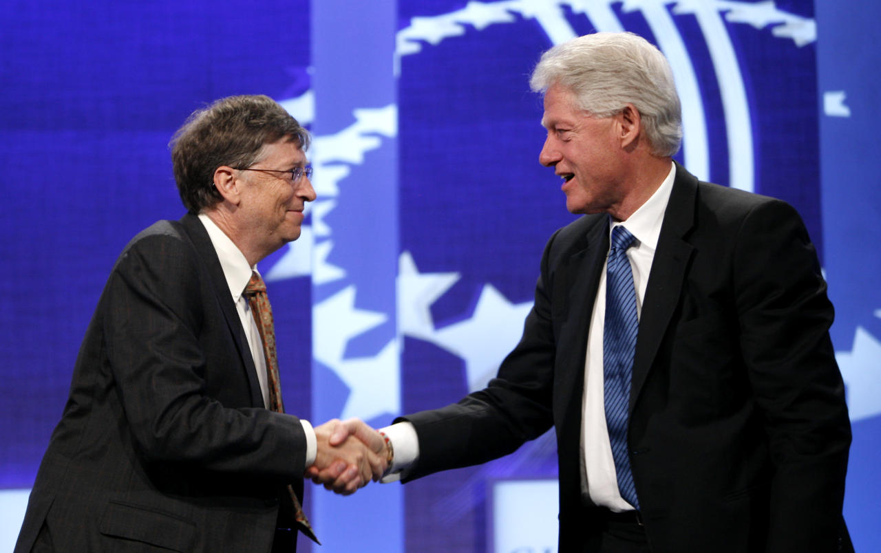Microsoft Chairman and former CEO Bill Gates, left, and former President Bill Clinton, right, shake hands before having a discussion on the subject of giving during the Clinton Global Initiative annual meeting Wednesday, Sept. 24, 2008 in New York. (AP Photo/Jason DeCrow)