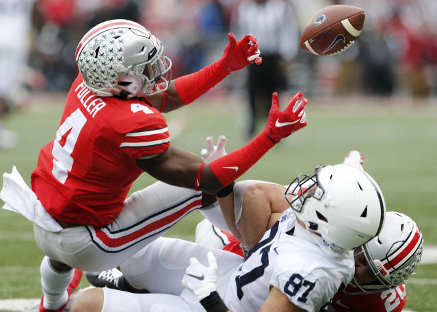 FILE - In this Nov. 23, 2019, file photo, Ohio State defensive back Jordan Fuller, left, breaks up a pass intended for Penn State tight end Pat Freiermuth during the first half of an NCAA college football game, in Columbus, Ohio. Fuller was selected to The Associated Press All-Big Conference team, Wednesday, Dec. 11, 2019.(AP Photo/Jay LaPrete, File)