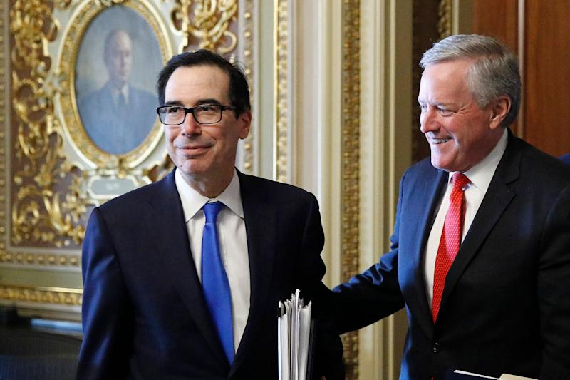 Treasury Secretary Steve Mnuchin, left, and White House chief of staff Mark Meadows step out of a meeting as the Senate negotiated a coronavirus relief bill in March. (Photo: ASSOCIATED PRESS)
