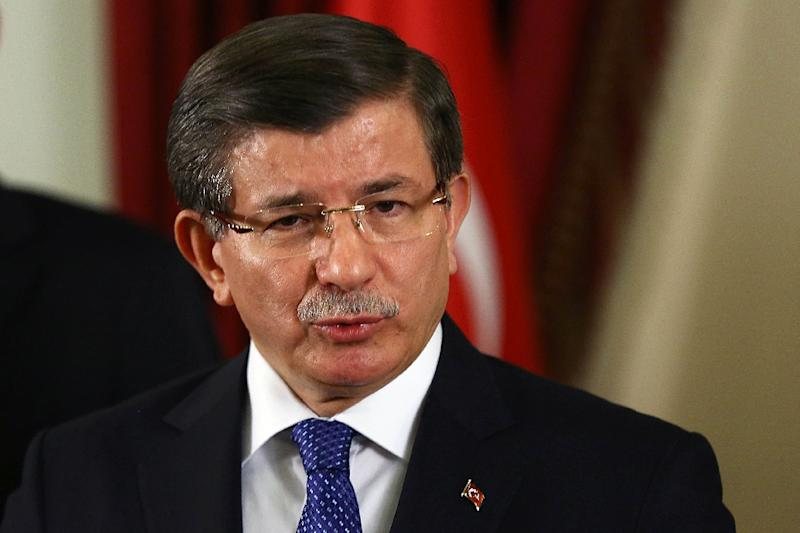 Turkish Prime Minister Ahmet Davutoglu speaks to the press after a security meeting in the governor's office in Ankara on February 20, 2016 (AFP Photo/Adem Altan)