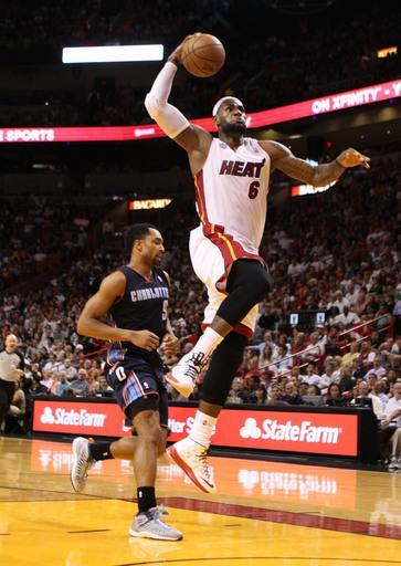 MIAMI, FL - MARCH 24: Forward LeBron James #6 of the Miami Heat dunks against the Charlotte Bobcats at American Airlines Arena on March 24, 2013 in Miami, Florida. (Photo by Marc Serota/Getty Images)