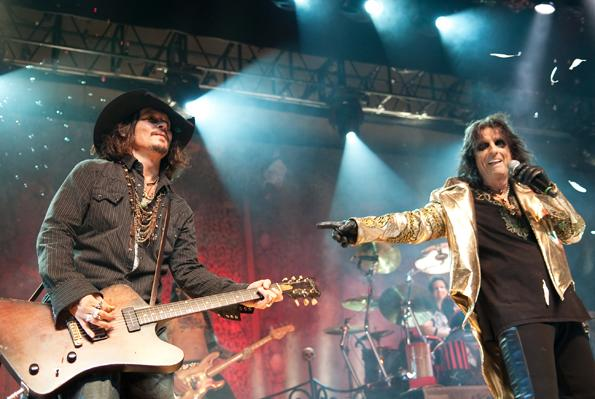 Johnny and Alice  Johnny Depp performs on stage with Alice Cooper at the Orpheum Theatre on November 29th, 2012 in Los Angeles. Related: • Johnny Depp's Rock & Roll Life: The Rolling Stone Covers, Film Pics and More