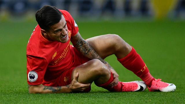 Liverpool were dealt a blow in the first half of their Premier League clash at Watford as Philippe Coutinho was injured.