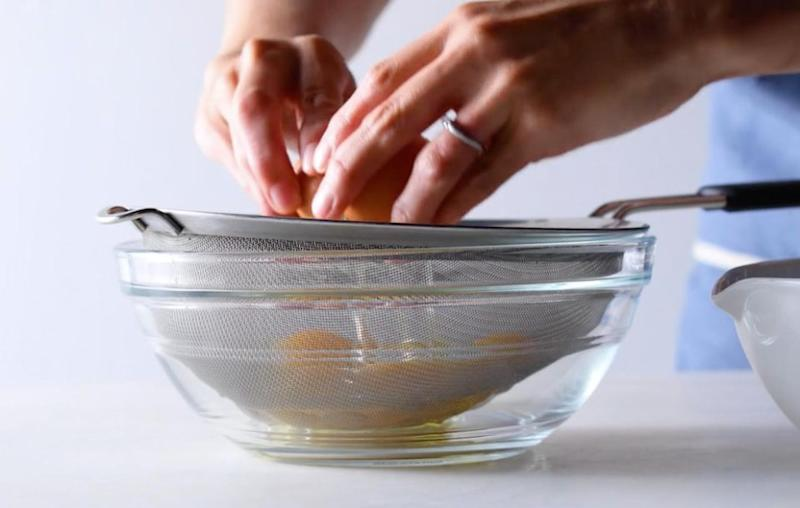 First you should strain your eggs in a sieve. Source: Food52 / Vimeo