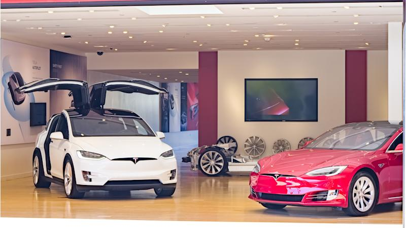 Tesla Model X and S in a Tesla store