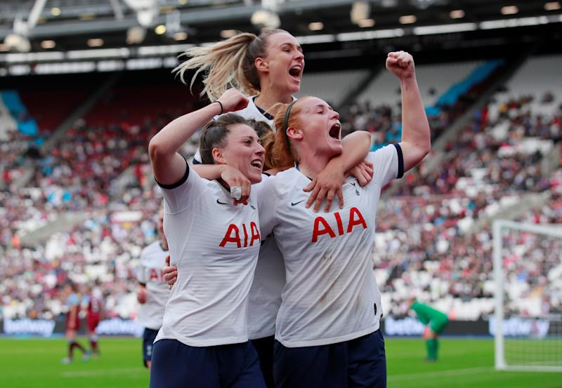 Tottenham Hotspur's Lucy Quinn celebrates scoring their second goal with team mates at the London Stadium Action Images via Reuters/Andrew Couldridge