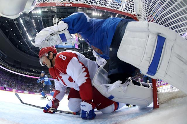 SOCHI, RUSSIA - FEBRUARY 19: Alexander Ovechkin #8 of Russia slides into the net of Tuukka Rask #40 of Finland during the Men's Ice Hockey Quarterfinal Playoff on Day 12 of the 2014 Sochi Winter Olympics at Bolshoy Ice Dome on February 19, 2014 in Sochi, Russia. (Photo by Martin Rose/Getty Images)