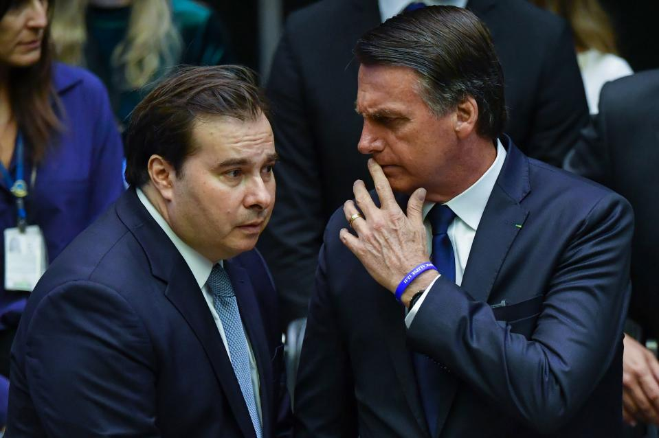 Brazil's newly sworn-in President Jair Bolsonaro (R) talks to Brazilian Lower House President Rodrigo Maia, during his inauguration ceremony, at the Congress in Brasilia on January 1, 2019. - Bolsonaro takes office with promises to radically change the path taken by Latin America's biggest country by trashing decades of centre-left policies. (Photo by NELSON ALMEIDA / AFP)        (Photo credit should read NELSON ALMEIDA/AFP via Getty Images)