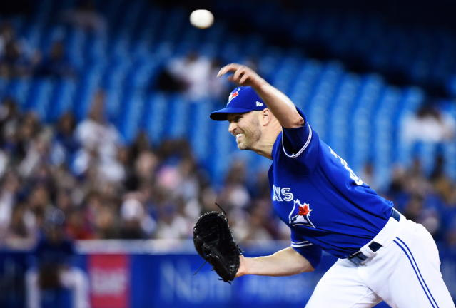 Toronto Blue Jays starting pitcher J.A. Happ throws to a Kansas City Royals batter during the first inning of a baseball game Wednesday, April 18, 2018, in Toronto. (Nathan Denette/The Canadian Press via AP)