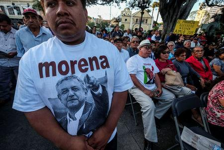 A man wears a T-shirt with a picture of Mexican politician Andres Manuel Lopez Obrador, leader of the National Regeneration Movement (MORENA) party during a meeting at Plaza Olivera in Los Angeles, California, U.S., February 12, 2017. REUTERS/Ringo Chiu