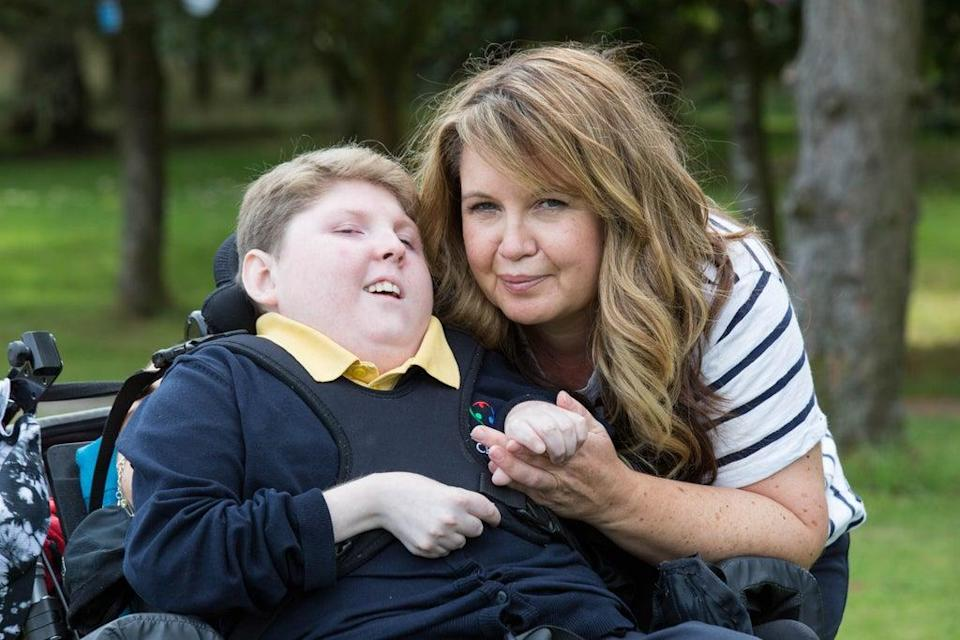 Donna Quinn with her son Logan at Craighalbert Centre, Cumbernauld (Robert Perry/PA) (PA Wire)