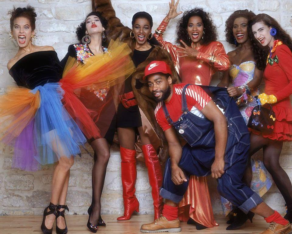 "<p>In 1998, Patrick Kelly became the first American designer accepted into the Chambre Syndicale du Prêt-à-porter in Paris, the prestigious French ready-to-wear association. After college, Kelly moved to Atlanta to work as a window dresser at the Yves Saint Laurent Rive Gauche boutique. Supermodel Pat Cleveland encouraged Kelly to move to Paris in 1980. Initially, Kelly struggled in Paris, freelancing for Paco Rabanne and making clothes for nightclubs to get by. His big break came when he became the first American designer sold in French boutique Victoire. This led to a feature in <em>ELLE</em> <em>France</em> and his first show in 1985. Kelly's pieces were beloved by Grace Jones, Madonna, and Princess Diana. He was known for his bright and bold garments, flashy body-con dresses, big buttons, and loud prints. Above all, Kelly was influenced by Black culture: <a href=""https://www.fastcompany.com/90305316/rediscovering-patrick-kelly-the-designer-who-made-blackface-his-brand"" rel=""nofollow noopener"" target=""_blank"" data-ylk=""slk:&quot;In one pew at Sunday church in Vicksburg, there's more fashion to be seen than on a Paris runway.&quot;"" class=""link rapid-noclick-resp"">""In one pew at Sunday church in Vicksburg, there's more fashion to be seen than on a Paris runway.""</a> As a Black man designing couture collections with Black women in mind, he was an anomaly. With a background in African history, Kelly used his brand as a way to confront racism by reclaiming symbols of Black oppression, such as the blackface he used as his logo. U.S. retailers refused to buy anything with this logo and his investors asked him to stop using it altogether. He died of AIDS in 1990.<br></p>"