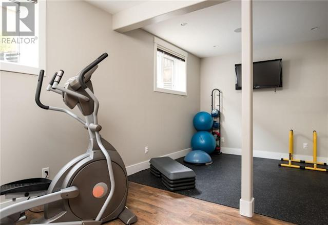 <p><span>209 Trillium Rd., Fort McMurray, Alta.</span><br> There are plenty of dedicated spaces in the home, such as this gym in the basement, or the dog shower in the garage.<br> (Photo: Zoocasa) </p>