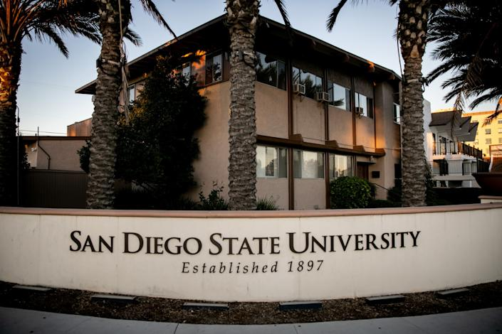 A sign for San Diego State University in front of the former Phi Gamma Delta fraternity house.