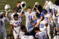 Florida quarterback Kyle Trask (11) joins head coach Dan Mullen, center, in singing their school song after an NCAA college football game against Vanderbilt Saturday, Nov. 21, 2020, in Nashville, Tenn. Florida won 38-17. (AP Photo/Mark Humphrey)