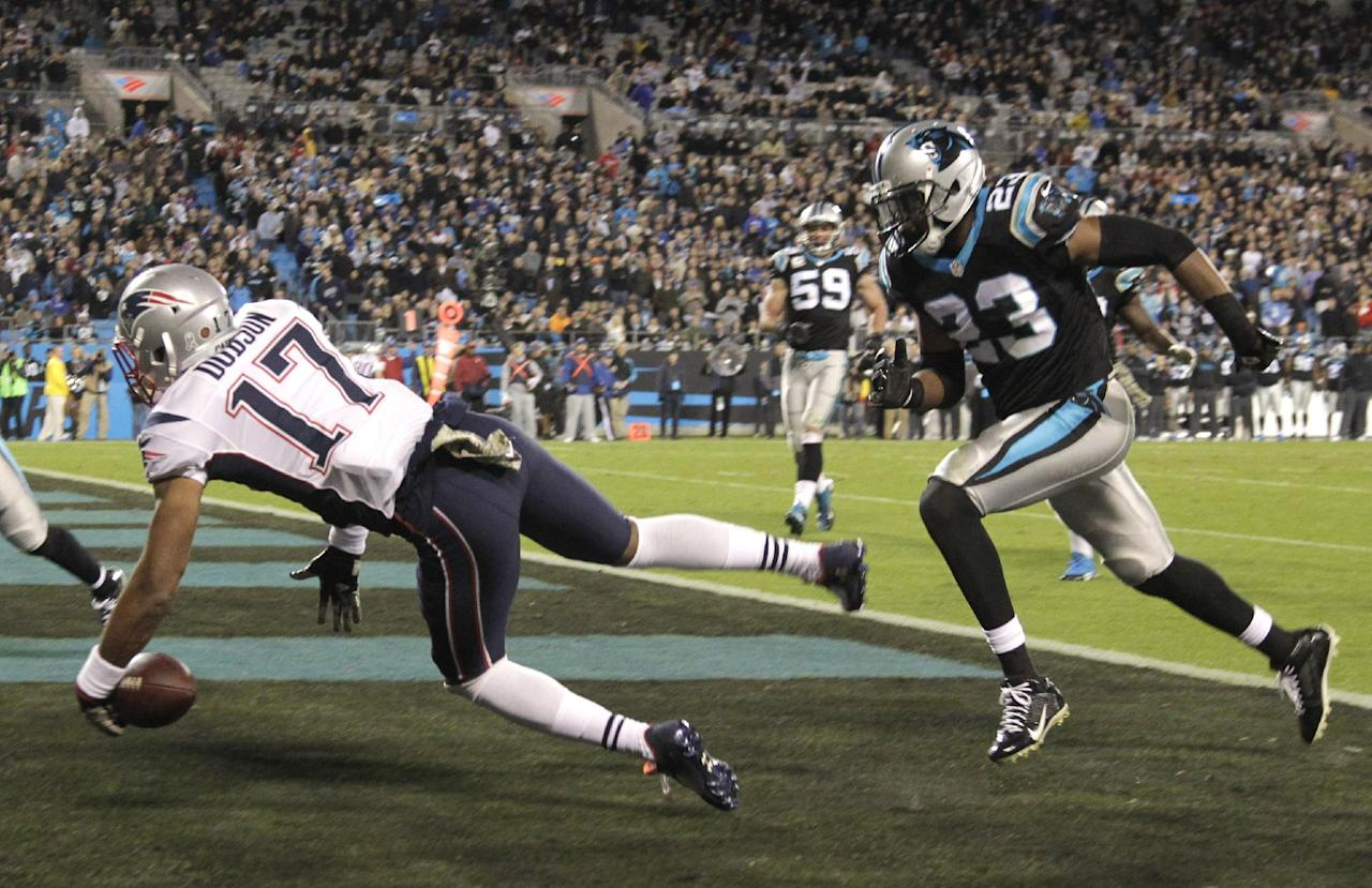 New England Patriots' Aaron Dobson (17) drops a pass in the end zone as Carolina Panthers' Melvin White (23) defends during the second half of an NFL football game in Charlotte, N.C., Monday, Nov. 18, 2013. (AP Photo/Bob Leverone)