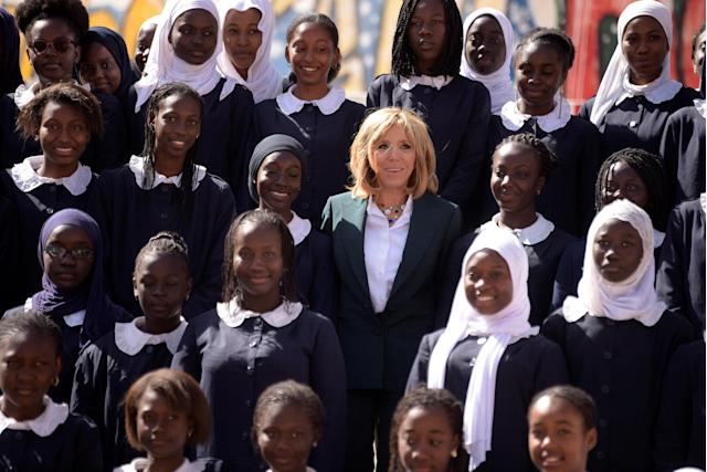 Brigitte Macron, the wife of the French president, poses with pupils of Mariama Ba school on Goree island, once a west African slaving post, off the coast of Dakar, Senegal, February 2, 2018. REUTERS/Sellou/Pool
