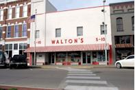 """<p>This photo snapped in the mid-2000s of the main street storefront of Walton's (a.k.a. <a href=""""https://www.redbookmag.com/life/g28170861/evolution-of-walmart-in-photos/"""" rel=""""nofollow noopener"""" target=""""_blank"""" data-ylk=""""slk:the very first Walmart"""" class=""""link rapid-noclick-resp"""">the very first Walmart</a>) in Bentonville, Arkansas, serves as a steady reminder that even the most successful supermarket in the world came from humble beginnings. </p>"""