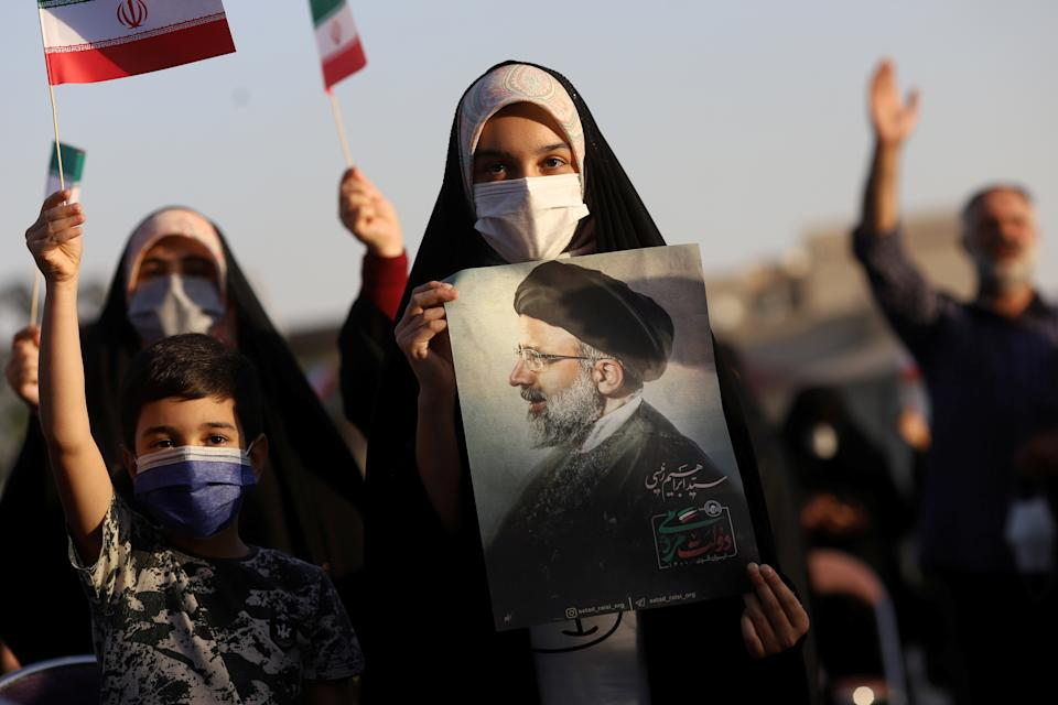 A supporter of Ebrahim Raisi displays his portrait during a celebratory rally for his presidential election victory in Tehran, Iran June 19, 2021. Majid Asgaripour/WANA (West Asia News Agency) via REUTERS ATTENTION EDITORS - THIS IMAGE HAS BEEN SUPPLIED BY A THIRD PARTY.     TPX IMAGES OF THE DAY