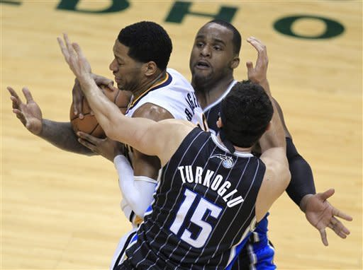 Indiana Pacers' Danny Granger, middle, is defended by Orlando Magic's Hedo Turkoglu, front, and Glen Davis during the first half of the second game of an NBA first-round playoff basketball series, Monday, April 30, 2012, in Indianapolis. (AP Photo/Darron Cummings)