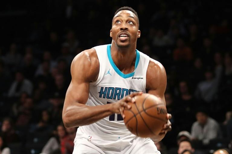 Charlotte's Dwight Howard scored 32 points and grabbed 30 rebounds, the first 30-30 performance since 2010 and only the second in 36 years, to lead the Hornets to a 111-105 triumph at Brooklyn