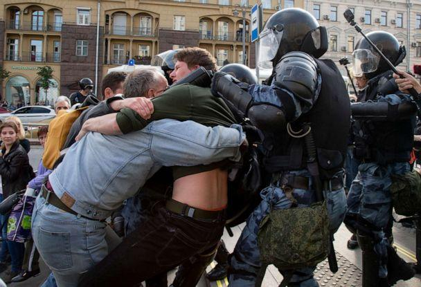 PHOTO: Police officers try to detain protestors during an unsanctioned rally in the center of Moscow, Russia, Aug. 3, 2019. (Alexander Zemlianichenko/AP, FILE)