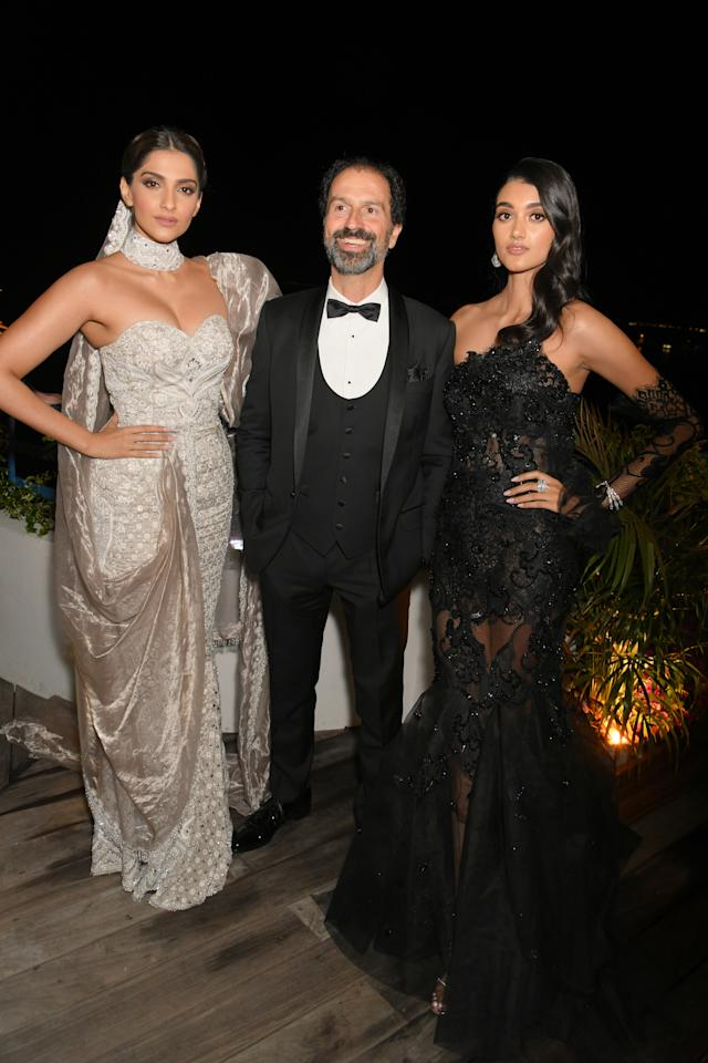 CANNES, FRANCE - MAY 20: (L-R) Sonam Kapoor, Patrizio Stella and Neelam Gill attend the Chopard Parfums 'La Nuit Des Rois' dinner party hosted by Caroline Scheufele and Patrizio Stella at Hotel Martinez on May 20, 2019 in Cannes, France. (Photo by David M. Benett/Dave Benett/Getty Images )
