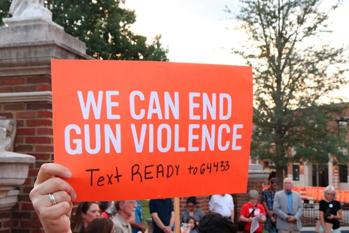 At a Moms Demand Action event, gun control advocates protest violence Aug. 5, 2019, in Auburn, Ala.