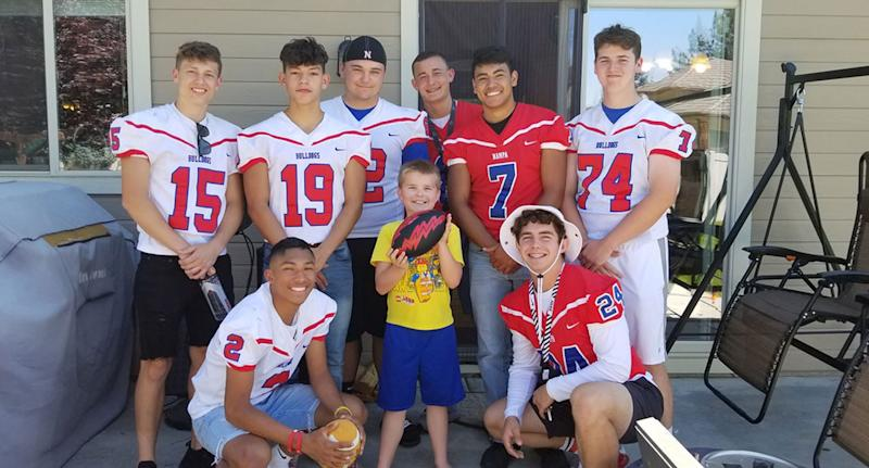 The nine-year-old posed with the eight star players who showed up to his birthday in Meridan, Idaho.