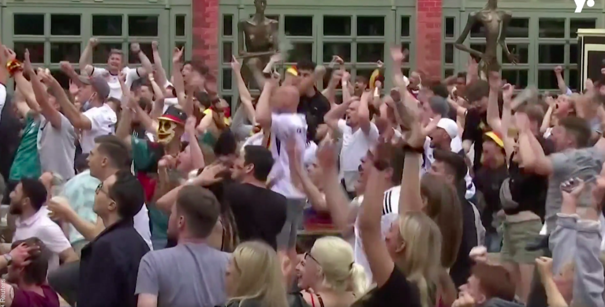 German fans celebrate what they thought was a Thomas Muller goal.