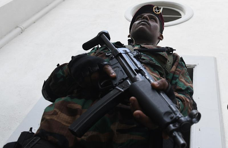 Soldiers armed with automatic assault rifles guarded St. Theresa's church in Colombo, while members of the congregation were searched for explosives (AFP Photo/LAKRUWAN WANNIARACHCHI)