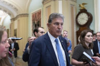 Sen. Joe Manchin, D-W.Va., speaks with reporters as he walks at the Capitol in Washington, Thursday, June 24, 2021. A bipartisan group of lawmakers have negotiated a plan to pay for an estimated $1 trillion compromise plan. (AP Photo/Alex Brandon)