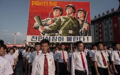 A propaganda poster on display during a rally in support of North Korea's stance against the USCredit: KIM WON-JIN/AFP/Getty Images