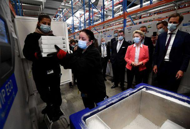 PHOTO: European Commission President Ursula von der Leyen, Pfizer CEO Albert Bourla and Belgium's Prime Minister Alexander De Croo watch workers moving boxes of vaccines from a freezer at the Pfizer factory in Puurs, Belgium, April 23, 2021.   (John Thys/Pool via Reuters)