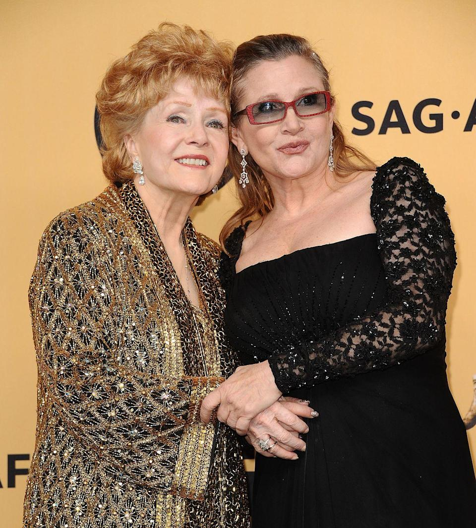 "<p>One day after losing her daughter, Debbie Reynolds suffered a fatal stroke. The <em>Singin' in the Rain </em>actress was 84 years old. ""She wanted to be with Carrie,"" Debbie's son, Todd Fisher, told <em><a href=""https://variety.com/2016/film/news/debbie-reynolds-dead-dies-carrie-fisher-mother-1201949432/"" rel=""nofollow noopener"" target=""_blank"" data-ylk=""slk:Variety"" class=""link rapid-noclick-resp"">Variety</a>. </em> </p>"