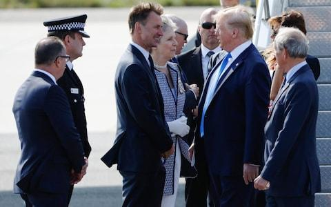 President Donald Trump is greeted by Jeremy Hunt at Stansted - Credit: Luke MacGregor/Bloomberg