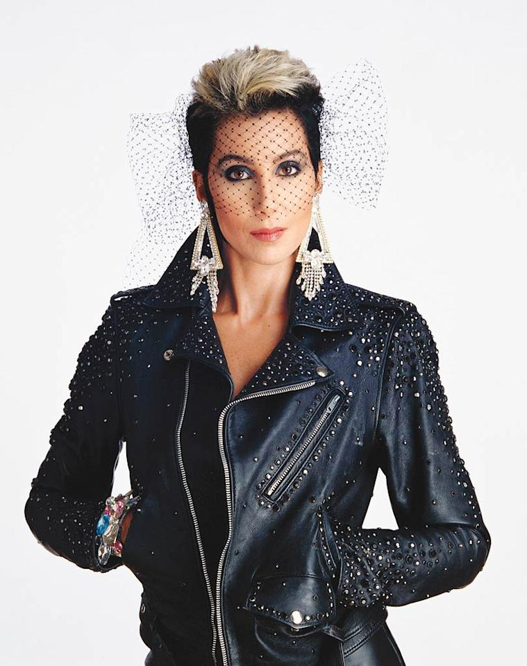 "<b>Circa 1980:</b> For a publicity photo that year, Cher wore a motorcycle jacket bought in Paris. She has had ""every color wig you can imagine,"" including this Pepe Le Pew pompadour. ""You cannot do things with your hair because all that styling ruins it. And I love my hair.""   <a href=""http://news.instyle.com/photo-gallery/?postgallery=23869?xid=omg-cher-supermodels?yahoo=yes"" target=""new"">The Original Supermodels: Then and Now</a> Douglas Kirkland/Corbis"