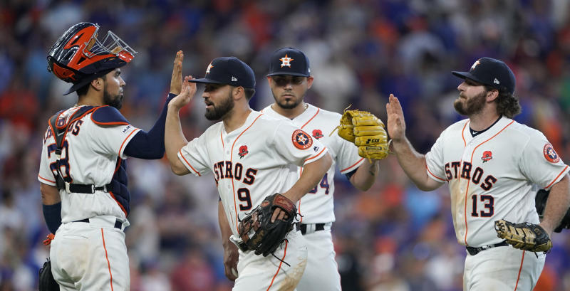 0ce9daa1f67f42 Cole fans 12 as Astros down Cubs 6-5