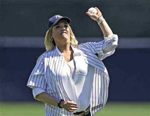 Florida Attorney General Pam Bondi throws out the ceremonial first pitch before a spring training baseball game between the New York Yankees and the Pittsburgh Pirates at Steinbrenner Field in Tampa, Fla., Thursday, March 28, 2013. (AP Photo/Kathy Willens)