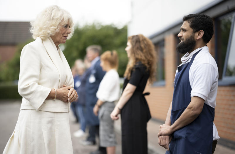 GLOUCESTER, ENGLAND - JULY 09: Camilla, Duchess of Cornwall speaks to a worker during a visit with Prince Charles, Prince of Wales to the Turnbull & Asser shirt factory on July 9, 2020 in Gloucester, United Kingdom. During the early stages of the Coronavirus pandemic the company switched their entire production line to making scrubs for the NHS. (Photo by Matthew Horwood/Getty Images)