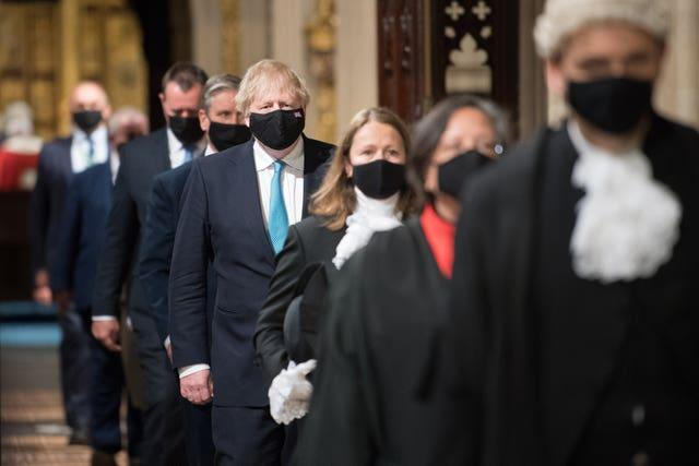 Prime Minister Boris Johnson (centre) processes through the Central Lobby with other party leaders on their way from the House of Lords after listening to the Queen's Speech during the State Opening of Parliament in the House of Lords (Stefan Rousseau/PA)