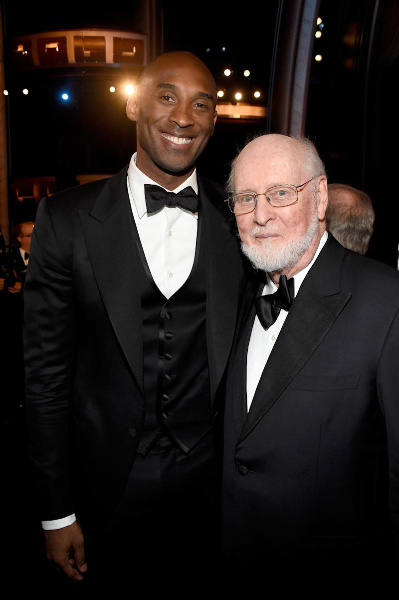 HOLLYWOOD, CA - JUNE 09: Retired NBA player Kobe Bryant (L) and honoree John Williams pose in the audience during American Film Institute's 44th Life Achievement Award Gala Tribute to John Williams at Dolby Theatre on June 9, 2016 in Hollywood, California. 26148_001 (Photo by Frazer Harrison/Getty Images for Turner)
