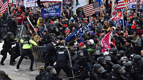 PHOTO: Trump supporters clash with police and security forces as they push barricades to storm the Capitol in Washington D.C., Jan. 6, 2021. (Roberto Schmidt/AFP via Getty Images)