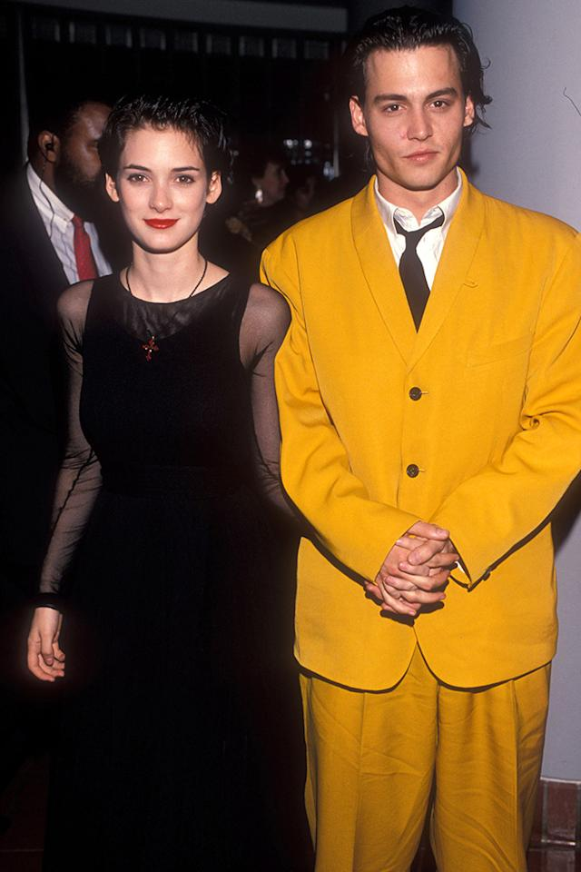 """<p>Ryder and Johnny Depp were once one of Hollywood's hottest It couples. (Depp famously had """"Winona Forever"""" tattooed on his arm.) She attended her then-fiance's premiere of <i>Cry Baby</i> on July 1, 1990. The two had met a year earlier at the premiere of her movie<i>Great Balls of Fire</i>. (Photo: Kevin Mazur Archive/WireImage)<br /></p>"""